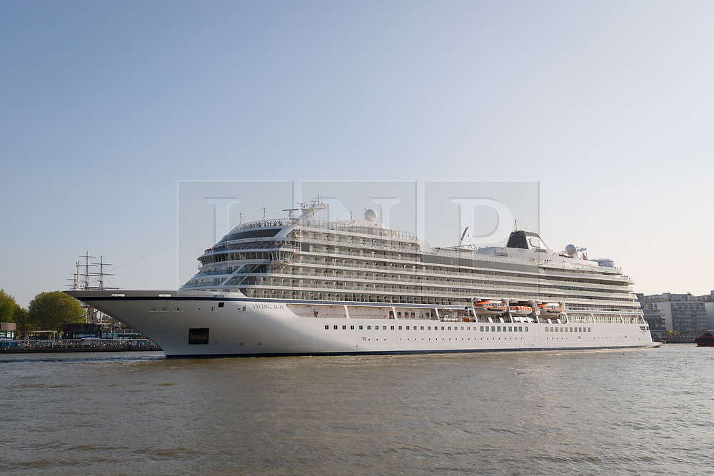 © Licensed to London News Pictures. 06/05/2018. London, UK. 228-metre-long cruise ship Viking Sun is seen making her way down the River Thames at the end of a 3 day visit to Greenwich in south east London. The visit by Viking Sun, which has a capacity of 930 passengers, marks the beginning of London's cruise ship season. For passengers on board, London was the end of a 141 night round the world cruise which started in Miami last December. Photo credit: Vickie Flores/LNP