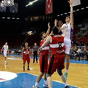 Anadolu Efes's Emircan Kosut (R) during their Turkish Basketball League match Anadolu Efes between Eskisehir Basket at Abdi Ipekci Arena in Istanbul Turkey on Sunday 14 December 2014. Photo by Aykut AKICI/TURKPIX