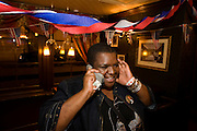 English lady calls home after Barack Obama is declared Presidential winner by CNN during overnight election party in London