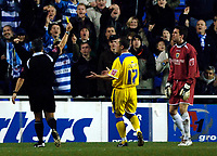 Photo: Daniel Hambury.<br />Reading v Cardiff City. Coca Cola Championship.<br />02/01/2006.<br />Cardiff's 'keeper Neil Alexander (R) is booked by referee Ray Olivier.