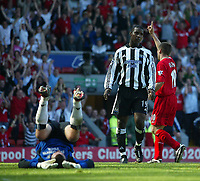 Photo. Andrew Unwin, Digitalsport<br /> NORWAY ONLY<br /> <br /> Liverpool v Newcastle United, FA Barclaycard Premier League, Anfield, Liverpool 15/05/2004.<br /> Newcastle's Shay Given (l) is left up-ended as Liverpool's Michael Owen (r) wheels away after scoring the equaliser.