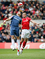 Photo: Richard Lane/Richard Lane Photography. Nottingham Forest v Cardiff City. Coca Cola Championship. 24/10/2008. Joel Lynch (R) and Paul Parry (L) in the air