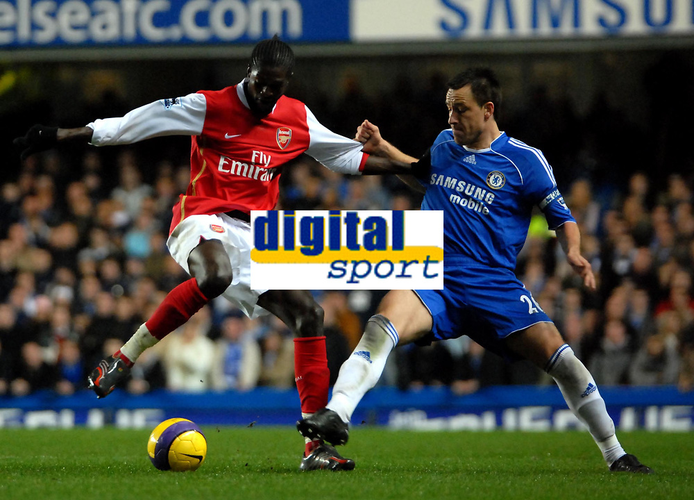 Photo: Ed Godden.<br /> Chelsea v Arsenal. The Barclays Premiership. 10/12/2006.<br /> Chelsea's John Terry (R), closes in on Emmanuel Adebayor.