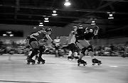 """""""Sassy Slayher"""" of the SF ShEvil Dead chases """"Grr Lee Burly"""" of the Oakland Outlaws during the Bay Area Derby Girls season opener in Oakland, CA. Both are jammers for the B.A.D. Girls' All-Stars Travel Team ranked #10 in the country...(©Matt McKnight, 2008)"""