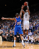 Kansas State forward Cartier Martin (20) hits a three pointer over DePaul defender Wilson Chandler (22), during second half action at Bramlage Coliseum in Manhattan, Kansas, March 19, 2007.  DePaul defeated Kansas State in the second round of the NIT 70-65.