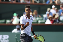 INDIAN WELLS, CALIFORNIA - MARCH 09: Felix Auger-Aliassime of Canada plays a forehand against Stefanos Tsitsipas of Greece during their men's singles second round match on day six of the BNP Paribas Open at the Indian Wells Tennis Garden on March 09, 2019 in Indian Wells, California..People: Felix Auger-Aliassime  (Credit Image: © SMG via ZUMA Wire)