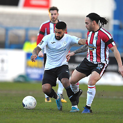 TELFORD COPYRIGHT MIKE SHERIDAN  Ellis Deeney of Telford holds off Tobias Mullarkey of Altrincham during the Vanarama Conference North fixture between AFC Telford United and Altrincham at The New Bucks Head on Saturday, February 1, 2020.<br /> <br /> Picture credit: Mike Sheridan/Ultrapress<br /> <br /> MS201920-044