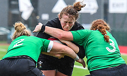Wales women's Caryl Thomas is tackled by Ireland women's Chodhna Moloney and Fiona Reidy<br /> <br /> Photographer Craig Thomas/Replay Images<br /> <br /> International Friendly - Wales women v Ireland women - Sunday 21th January 2018 - CCB Centre for Sporting Excellence - Ystrad Mynach<br /> <br /> World Copyright © Replay Images . All rights reserved. info@replayimages.co.uk - http://replayimages.co.uk