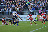Gloucester full back Billy Burns (15) passes the ball to the wing during the Aviva Premiership match between Bath Rugby and Gloucester Rugby at the Recreation Ground, Bath, United Kingdom on 29 October 2017. Photo by Gary Learmonth.