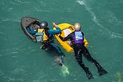 River boarders swim in Kawarau River Gorge, Canterbury region, South Island, New Zealand.