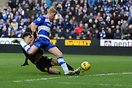 Reading's Pavel Pogrebnyak is tackled by Wigan's Paul Scharner as he goes for a shot at goal. Barclays Premier league, Reading v Wigan Athletic at the Madejski Stadium in Reading on Saturday 23rd Feb 2013. pic by Andrew Orchard, Andrew Orchard sports photography,