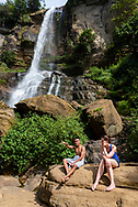 A young man from Sri Lanka and a young woman from Switzerland who is traveling in Sri Lanka, talk together at Ramboda Falls. (April 8, 2017)