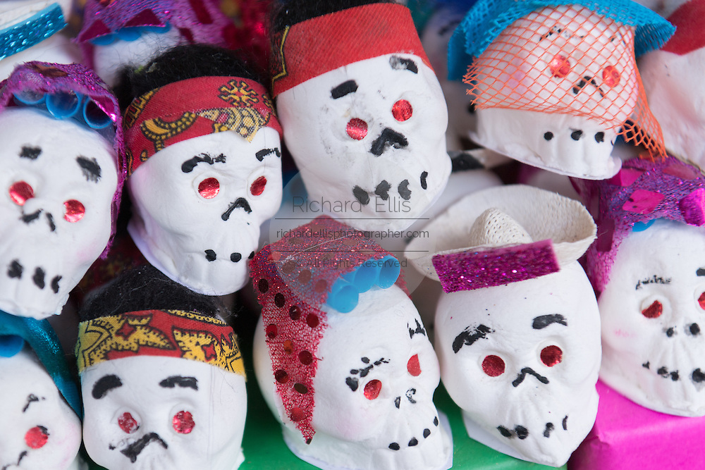 Decorated folk art sugar skulls representing departed soul on sale at a street market in preparation for the Day of the Dead festival October 26, 2016 in Comonfort, Guanajuato, Mexico. The celebration is a time when Mexicans welcome the dead back to earth for a visit and celebrate life.