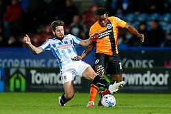 Kazenga LuaLua of Brighton is tackled by Jacob Butterfield of Huddersfield Town - Photo mandatory by-line: Rogan Thomson/JMP - 07966 386802 - 21/10/2014 - SPORT - FOOTBALL - Huddersfield, England - The John Smith's Stadium - Huddersfield Town v Brighton & Hove Albion - Sky Bet Championship.
