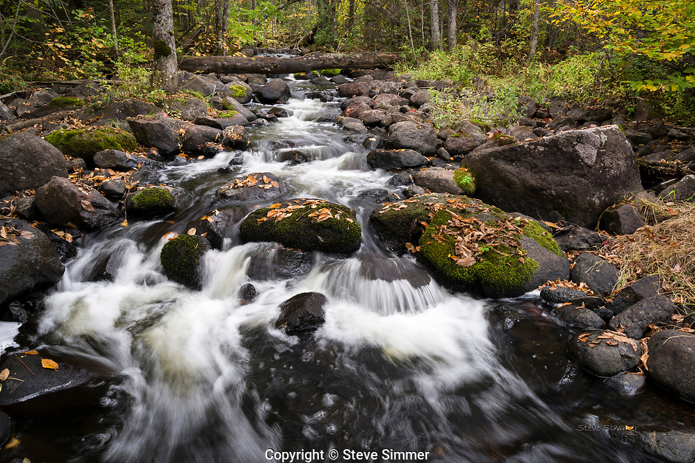 In the Superior National Forest north of Tofte, the Tait river runs through the forest and alongside the gravel roads almost unseen and unnoticed.
