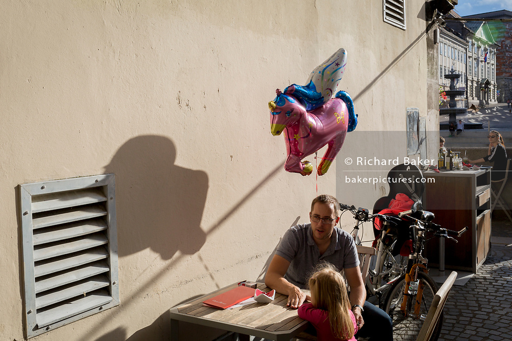 A child's balloon shadow on the wall of a cafe off Cankarjevo Nabrezje in the Slovenian capital, Ljubljana, on 25th June 2018, in Ljubljana, Slovenia.
