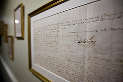 © Licensed to London News Pictures. 10/12/2012. London, UK. The signature of Charles Dickens is seen with letters by the author on the wall of the Charles Dickens Museum, which re-opened in  London today (10/12/12). The museum, spread over 4 floors, is housed in the building where Dickens lived with his wife from March 1837 to December 1839 and where he authored some of his famous titles including the Pickwick Papers, Nicholas Nickleby and Oliver Twist. Photo credit: Matt Cetti-Roberts/LNP