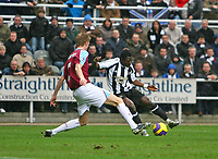 Photo: Andrew Unwin.<br /> Newcastle United v West Ham United. The Barclays Premiership. 20/01/2007.<br /> Newcastle's Obafemi Martins (R) tries to get past West Ham's Callum Davenport (L).
