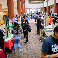 Students take to Gurley Hall to present interactive educational displays and materials focused on peoples' lived experiences, both locally and globally  at the University of New Mexico in Gallup Thursday.