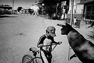2/5: Boy with bike in the town of Aralsk  / Aralsk region, Kazakhstan