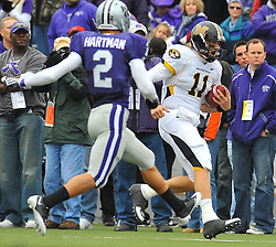 Nov 14, 2009; Manhattan, KS, USA; Missouri quarterback Blaine Gabbert (11) runs for yardage in the first quarter as Kansas State defensive back Tysyn Hartman (2) attempts the tackle at Bill Snyder Family Stadium. Mandatory Credit: Denny Medley-US PRESSWIRE