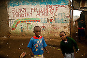 Nairobi, June 2010 -  local kids outside the front of the Siloam Fellowship ministry Academy in Kibera slum.