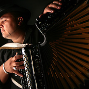 Rocky Beltran plays the accordion for Los Badd Boyz del Valle. The month of June brings the key instrument of tejano, norteno and conjunto music center stage as National Accordion Awareness Month.<br /> Nathan Lambrecht/The Monitor