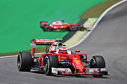 Kimi Raikkonen (FIN) Ferrari SF16-H as team mate Sebastian Vettel (GER) Ferrari SF16-H spins.<br /> 11.11.2016. Formula 1 World Championship, Rd 20, Brazilian Grand Prix, Sao Paulo, Brazil, Practice Day.<br /> Copyright: Moy / XPB Images / action press