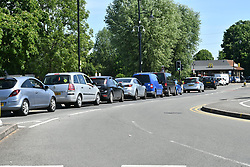 © Licensed to London News Pictures. 20/05/2020. Staines, UK. Long queues at a Macdonalds Drive Thru in Staines, Surrey. Branches of Macdonalds restaurants have opened for drive thru today for the fist time since locksdon.  todayGovernment has announced a series of measures to slowly ease lockdown, which was introduced to fight the spread of the COVID-19 strain of coronavirus. Photo credit: Ben Cawthra/LNP
