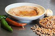 Hummus. A Levantine Arab dip or spread made from cooked, mashed chickpeas, blended with tahini, olive oil, lemon juice, salt and garlic.