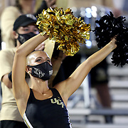ORLANDO, FL - OCTOBER 03:  A member of the Central Florida cheer team dances while wearing a face mask against the Tulsa Golden Hurricane at Bright House Networks Stadium on October 3, 2020 in Orlando, Florida. (Photo by Alex Menendez/Getty Images) *** Local Caption ***
