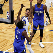 ORLANDO, FL - FEBRUARY 19:  Kelly Oubre Jr. #12 of the Golden State Warriors shoots over Al-Farouq Aminu #2 of the Orlando Magic as Terrence Ross #31 of the Orlando Magic looks on during the second half at Amway Center on February 19, 2021 in Orlando, Florida. NOTE TO USER: User expressly acknowledges and agrees that, by downloading and or using this photograph, User is consenting to the terms and conditions of the Getty Images License Agreement. (Photo by Alex Menendez/Getty Images)*** Local Caption *** Kelly Oubre Jr.; Al-Farouq Aminu; Terrence Ross