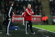 Alan Curtis, the Swansea city caretaker manager © looks on from his technical area. Barclays Premier league match, Swansea city v West Bromwich Albion at the Liberty Stadium in Swansea, South Wales  on Boxing Day Saturday 26th December 2015.<br /> pic by  Andrew Orchard, Andrew Orchard sports photography.