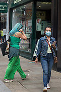 A shopper wears a face covering to help prevent the spread of the coronavirus on 26th August 2020 in Windsor, United Kingdom. Tessa Lindfield, the Director of Public Health for Berkshire, has urged residents of the Royal Borough of Windsor and Maidenhead to follow social distancing guidelines following a significant rise in the number of positive COVID-19 tests there over the past week.