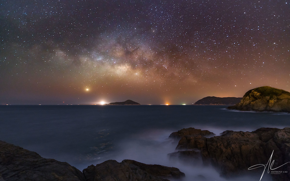 Galaxy capture right before sunrise at the Cape D'Aguila ocean reserve area in Hong Kong.