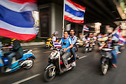22 DECEMBER 2013 - BANGKOK, THAILAND:  Anti-government protestors ride their motorcycles through central Bangkok. Hundreds of thousands of Thais gathered in Bangkok Sunday in a series of protests against the caretaker government of Yingluck Shinawatra. The protests are a continuation of protests that started in early November and have caused the dissolution of the Pheu Thai led government of Yingluck Shinawatra. Protestors congregated at home of Yingluck and launched a series of motorcades that effectively gridlocked the city. Yingluck was not home when protestors picketed her home.    PHOTO BY JACK KURTZ
