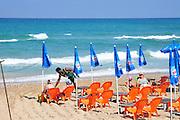 Israel, Haifa, Carmel Beach, Israelis go to the Beach on a warm, sunny day. .