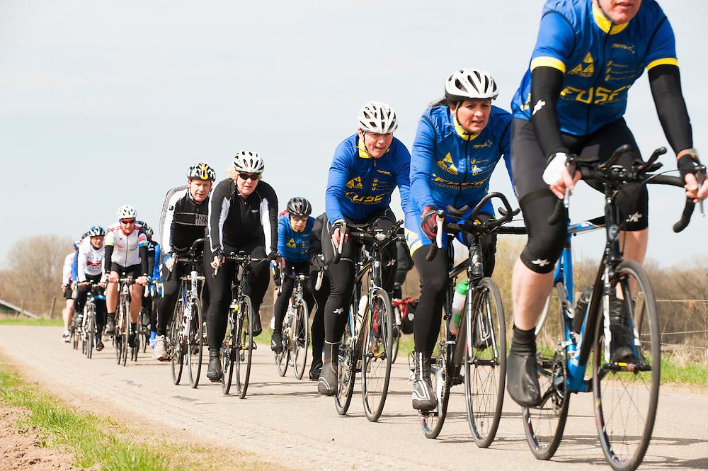 Nederland, Amerongen, 21 april 2013<br /> Amateur racefietsers in groepen op de dijk bij Amerongen. <br /> Foto(c): Michiel Wijnbergh