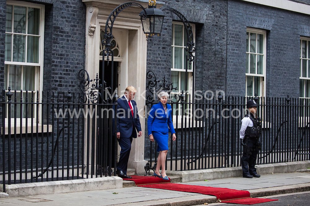 London, UK. 4 June, 2019. US President Donald Trump and Prime Minister Theresa May leave 10 Downing Street for more bilateral talks in the Foreign and Commonwealth Office on the second day of his state visit to the UK.