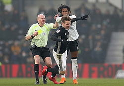 Derby County's Kasey Palmer and Fulham's Stefan Johansen battle for the ball clash during the match at Pride Park Stadium
