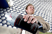 Drinks market shaken up by Birmingham entrepreneur's cocktail idea.A new drinks brand born in Birmingham is set to revolutionise the way we drink cocktails at home..Tails is the brainchild of young entrepreneur Nick Wall, who has taken the germ of an idea in 2007 and developed it into a premium brand that is set to be launched in one of Britain's leading retailers today..The product, a sophisticated range of cocktails packaged in real shakers, will be sold exclusively for five weeks across Selfridges' four stores in Birmingham, Manchester and London before being rolled out to other high-end retailers..Backed by support from the Manufacturing Advisory Service-West Midlands (MAS-WM)'s New Product Development Programme and Business Link, the company expects first year activity to generate sales in excess of £600,000 with plans already in place to add new flavours to the existing three-strong range, look at promotional gift ideas and explore diversification. Pictured is Nick Wall from Tails and Roy Pulley Innovation Team Leader from MAS-WM (tie).Picture by Shaun Fellows/Shine Pix.