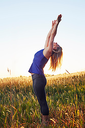Oct. 11, 2014 - Mature woman practising yoga on field (Credit Image: © Image Source/Image Source/ZUMAPRESS.com)