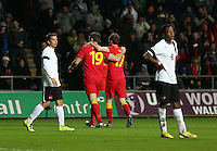 Pictured: Samuel Vokes of Wales (19) celebrating his goal with team mate. Andrew King (17) while Austria players stand dejected. Wednesday 06 February 2013..Re: Vauxhall International Friendly, Wales v Austria at the Liberty Stadium, Swansea, south Wales.