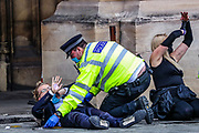 Extinction Rebellion activists, co-founder and spokesperson Robin Boardman who glued themselves in front of the Peers Gate, outside Westminster Palace of the Houses of Parliament, is handcuffed and expect to be taken by the Police, Thursday, Sept 3, 2020. Environmental non-violent activists group Extinction Rebellion enters its 3rd day of continuous ten days to disrupt political institutions throughout peaceful actions swarming central London into a standoff, demanding that central government obeys and delivers Climate Emergency bill.