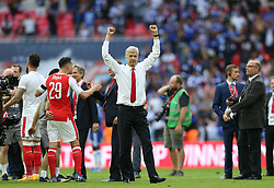 FILE PHOTO: Arsene Wenger is to leave Arsenal at the end of the season, ending a near 22-year reign as manager<br /><br />Arsenal's manager Arsene Wenger celebrates winning the FA Cup against Chelsea during the FA Cup Final match at Wembley Stadium ... Arsenal v Chelsea - Emirates FA Cup - Final - Wembley Stadium ... 27-05-2017 ... London ... UK ... Photo credit should read: Barrington Coombs/EMPICS Sport. Unique Reference No. 31480237 ...