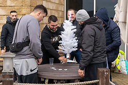© Licensed to London News Pictures. 22/12/2020. London, UK. Romanian nationals decorate a mini Christmas tree as they wait to cross the English Channel. The Port of Dover remains closed due to the response to France closing its borders to the UK. All freight and passenger traffic have been banned for 48 hours due to the new mutant strain of the Coronavirus in England. Photo credit: London News Pictures