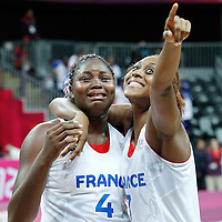 07 August 2012: France Isabelle Yacoubou cries after seeing a marriage proposal from her fiance next to Sandrine Gruda following 71-68 Team France victory over Team Czech Republic, during the women's basketball quarter-finals, at the Basketball Arena, in London, Great Britain.