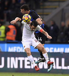 MILAN, Jan. 22, 2018  Roma's Alessandro Florenzi (Front) vies with Inter Milan's Ivan Perisic during a Serie A soccer match between Inter Milan and Roma in Milan, Italy, Jan. 21, 2018. The game ends with a 1-1 tie. (Credit Image: © Alberto Lingria/Xinhua via ZUMA Wire)