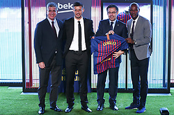 July 13, 2018 - Barcelona, Catalonia, Spain - Josep Maria Bartomeu, president of FC Barcelona, Jordi Mestre, vicepresident of FC Barcelona, and Eric Abidal, technical director, during the presentation of Clement Lenglet as a new player of FC Barcelona, on 13th July, 2018, in Barcelona, Spain. (Credit Image: © Joan Valls/NurPhoto via ZUMA Press)