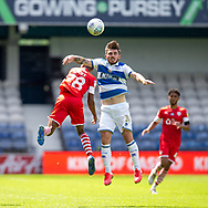 Queens Park Rangers forward Ryan Manning (14) clashes in the air with Barnsley forward Elliot Simões (28) during the EFL Sky Bet Championship match between Queens Park Rangers and Barnsley at the Kiyan Prince Foundation Stadium, London, England on 20 June 2020.